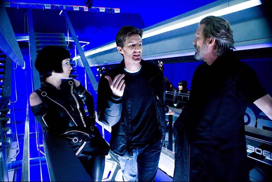 Olivia Wilde (Left), Joseph Kosinski (Middle), and Jeff Bridges (Right)